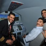 Maradona tests his aerial skills on an Emirates' flight simulator