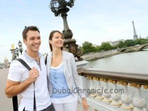 Couple in Paris walking on the bridge Alexander the Third