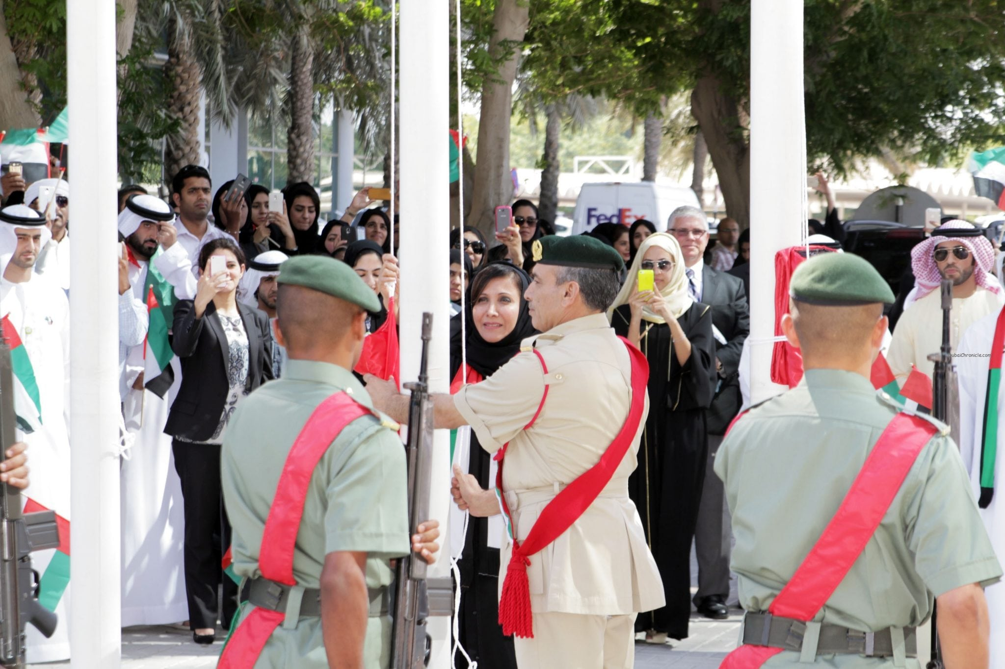 HE Salma Ali Saif Bin Hareb, CEO of Economic Zones World hoisting national flag in -Jafza