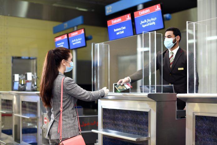 Dubai Health Authority (DHA) interacting with a women at their kiosk