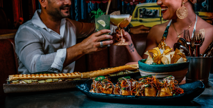 A lively and dynamic atmosphere awaits those who step in the traditional entradas ofRumba Cuban Bar & Kitchen